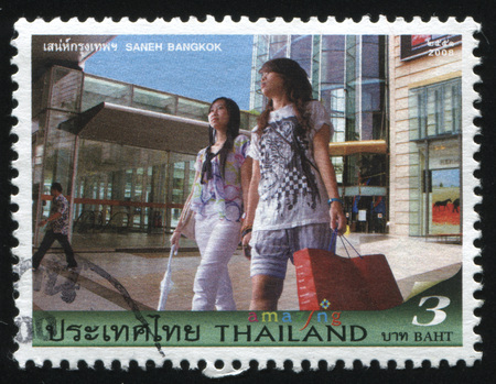 RUSSIA KALININGRAD, 31 MAY 2016: stamp printed by Thailand, shows two women going shopping, circa 2008