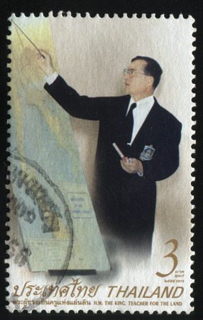 adulyadej: RUSSIA KALININGRAD, 2 JUNE 2016: stamp printed by Thailand shows king Bhumibol Adulyadej, circa 2003 Editorial