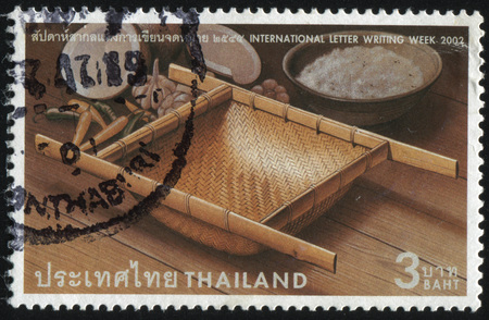 bolter: RUSSIA KALININGRAD, 2 JUNE 2016: stamp printed by Thailand, shows table appointments: plates of food and flowers, circa 2002