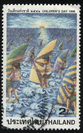 numberplate: RUSSIA KALININGRAD, 31 MAY 2016: stamp printed by Thailand, shows childrens drawing of windsurfing people, circa 1998 Editorial