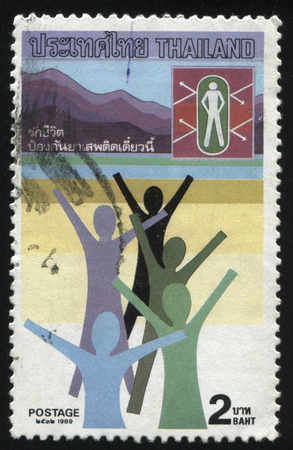 croud: RUSSIA KALININGRAD, 2 JUNE 2016: stamp printed by Thailand, shows abstract people, rasing their hands on the beach, circa 1989