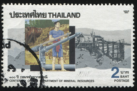 rockslide: RUSSIA KALININGRAD, 31 MAY 2016: stamp printed by Thailand, shows illustration of a oil worker, dedicated to centenary of the department of mineral resources, circa 1992
