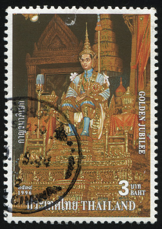 RUSSIA KALININGRAD, 31 MAY 2016: stamp printed by Thailand, shows painting of King Bhumibol Adulyadej on throne  in palace, dedicated to golden jubilee, circa 1996