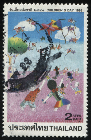 afield: RUSSIA KALININGRAD, 31 MAY 2016: stamp printed by Thailand, shows childrens drawing of kids with kites afield, circa 1998