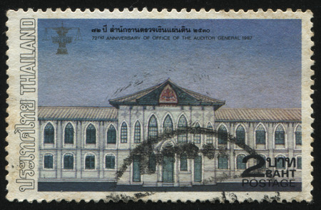 bureaucratism: RUSSIA KALININGRAD, 31 MAY 2016: stamp printed by Thailand, shows illustration of public agency, dedicated to 72th anniversaryof office of the auditor general, circa 1987 Editorial