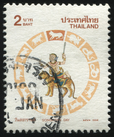 bull snake: RUSSIA KALININGRAD, 3 JUNE 2016: stamp printed by Thailand, shows person in mask on the tiger, circa 1998 Editorial