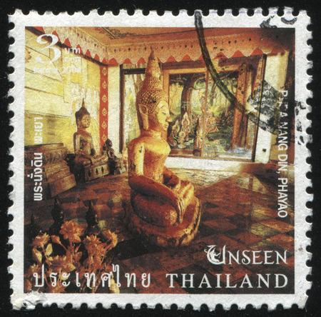 phra nang: RUSSIA KALININGRAD, 4 JUNE 2016: stamp printed by Thailand, shows golden Buddha statue profile in the Phra Nang Din, Phayao temple, circa 2004 Editorial