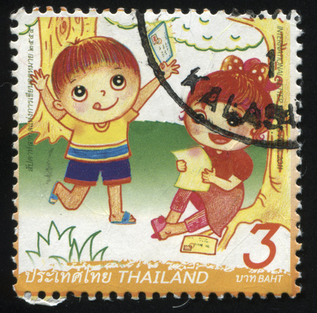 interweave: RUSSIA KALININGRAD, 3 JUNE 2016: stamp printed by Thailand, shows children, reading postcards in the forest, circa 2011