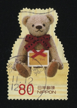 RUSSIA KALININGRAD, 18 MARCH 2016: stamp printed by Japan shows Teddy bear, circa 2012 Editorial