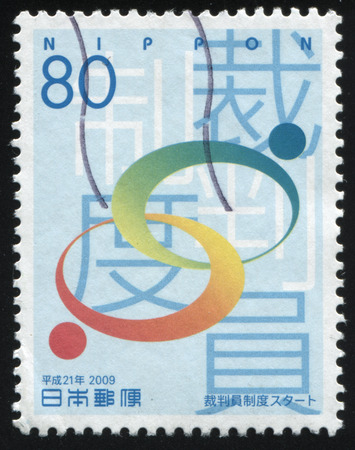 ideograph: RUSSIA KALININGRAD, 18 MARCH 2016: stamp printed by Japan, shows two crossing red and green circles, circa 2009 Editorial