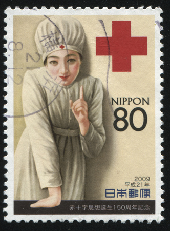 benevolent: RUSSIA KALININGRAD, 18 MARCH 2016: stamp printed by Japan, shows a nurse on red cross background, circa 2009