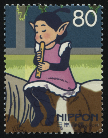 female leprechaun: RUSSIA KALININGRAD, 18 MARCH 2016: stamp printed by Japan, shows horse and girl, circa 2005