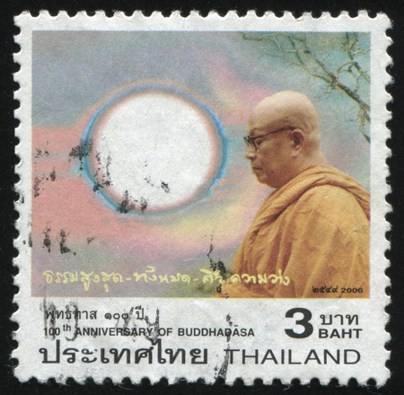 cassock: RUSSIA KALININGRAD, 3 JUNE 2016: stamp printed by Thailand, shows a praying monk in the sunshine, circa 2006 Editorial