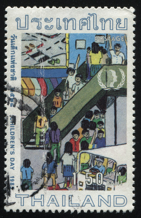 overcrowded: RUSSIA KALININGRAD, 2 JUNE 2016: stamp printed by Thailand, shows children in the city, 1985 Editorial