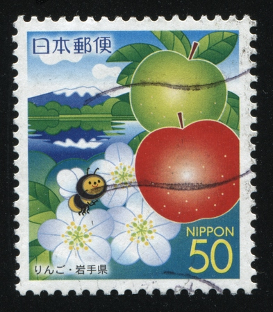 RUSSIA KALININGRAD, 18 MARCH 2016: stamp printed by Japan, shows a cartoon bee flying over the river, flowers and apples, circa 2009 Editorial