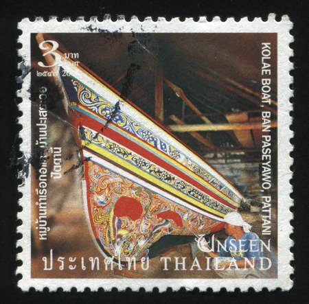 pattani thailand: RUSSIA KALININGRAD, 3 JUNE 2016: stamp printed by Thailand, shows a painter, coloring a Kolae Boat, Banboat, circa 2004