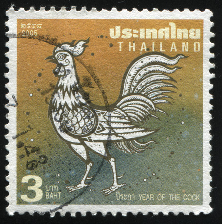 RUSSIA KALININGRAD, 3 JUNE 2016: stamp printed by Thailand, shows white rooster on yellow background, circa 2005 Editorial