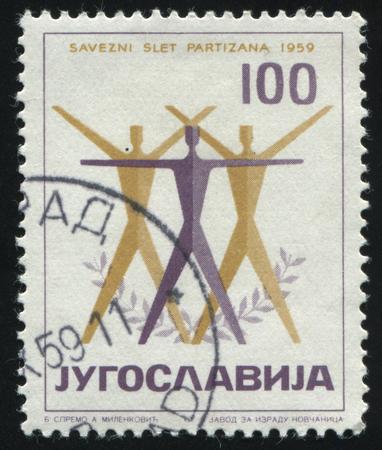 yugoslavia: RUSSIA KALININGRAD, 12 NOVEMBER 2016: stamp printed by Yugoslavia, shows post stamp printed in Yugoslavia shows an emblem of Physical Culture Festival, circa 1959 Editorial
