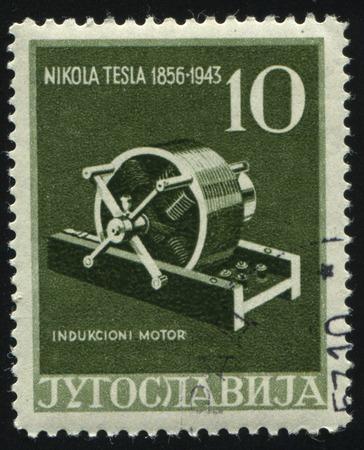 resourse: RUSSIA KALININGRAD, 12 NOVEMBER 2016: stamp printed by Yugoslavia, shows Induction Motor, circa 1956