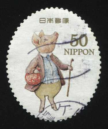 pedant: RUSSIA KALININGRAD, 22 APRIL 2016: stamp printed by Japan, shows pig in clothes, circa 2011