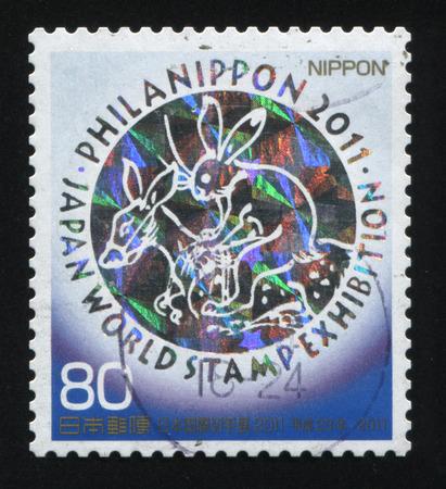 stubbornness: RUSSIA KALININGRAD, 22 APRIL 2016: stamp printed by Japan, shows bunny riding donkey, circa 2011