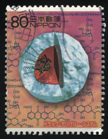 formulae: RUSSIA KALININGRAD, 22 APRIL 2016: stamp printed by Japan, shows a structure of an atom and with chemical formulae on the background, circa 2013