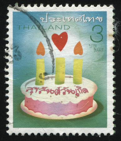 interweave: RUSSIA KALININGRAD, 3 JUNE 2016: stamp printed by Thailand, shows holiday cake with candles, circa 2005