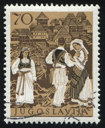 bosnia hercegovina: RUSSIA KALININGRAD, 12 NOVEMBER 2016: stamp printed by Yugoslaviya, shows a National costume of Bosnia and Hercegovina, circa 1957