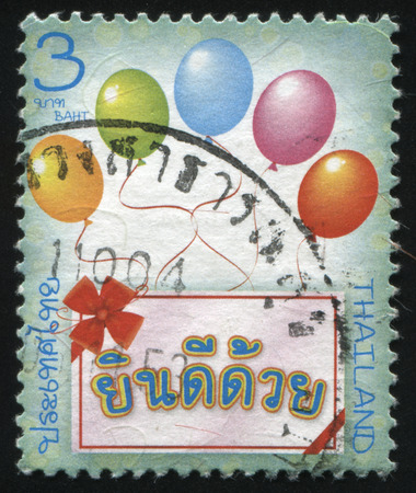interweave: RUSSIA KALININGRAD, 3 JUNE 2016: stamp printed by Thailand, shows greeting card and balloons, circa 2005 Editorial