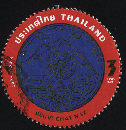 nat: RUSSIA KALININGRAD, 4 JUNE 2016: stamp printed by Thailand, shows a blue mountain with the Buddha wheel in the centre (emblem of Chai Nat), circa 2008