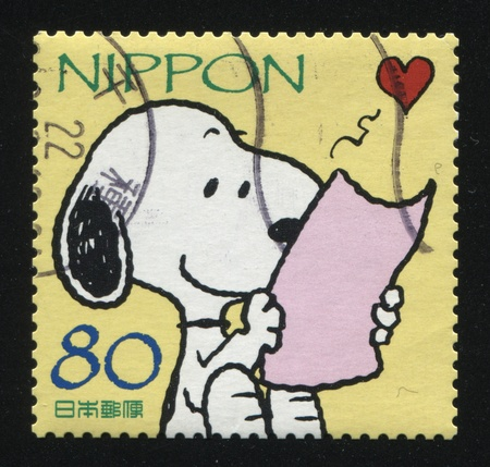 RUSSIA KALININGRAD, 18 MARCH 2016: stamp printed by Japan, shows dog reading love letter, circa 2010 Editorial