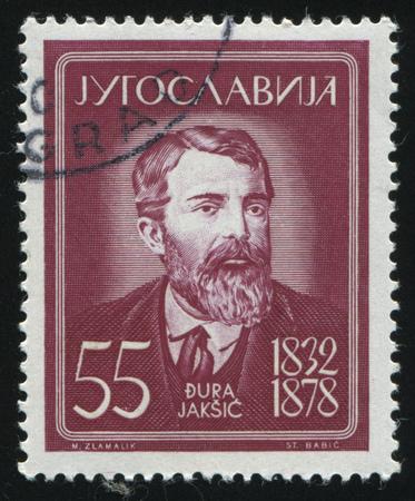 dramatist: RUSSIA KALININGRAD, 12 NOVEMBER 2016: stamp printed by Yugoslavia, shows the Portrait of Dura Jaksic, circa 1960 Editorial