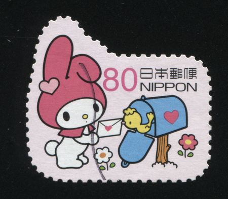 RUSSIA KALININGRAD, 19 APRIL 2016: stamp printed by Japan, shows a  cartoon rabbit that tries to put the letter into the pstbox, circa 2011