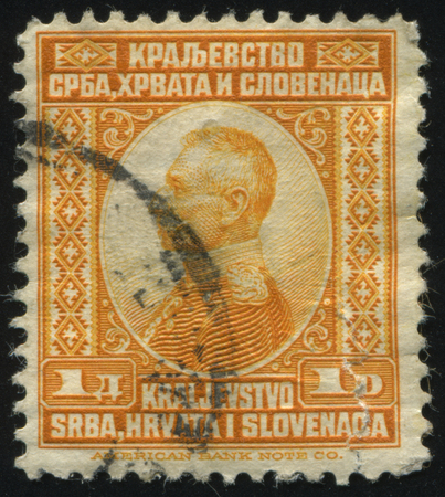 the statesman: RUSSIA KALININGRAD,12 NOVEMBER 2016: stamp printed by Yugoslavia, shows the portrait of King Peter I, circa 1921 Editorial