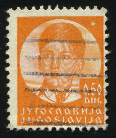RUSSIA KALININGRAD,12 NOVEMBER 2016: stamp printed by Yugoslavia, shows the portrait of king Peter II, circa 1935