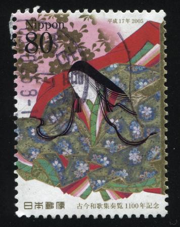 RUSLAND KALININGRAD, 22 APRIL 2016: stempel gedrukt door Japan, toont zittende vrouw gekleed in traditionele Japanse kleding, circa 2005 Redactioneel