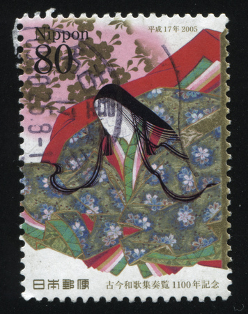 RUSSIA KALININGRAD, 22 APRIL 2016: stamp printed by Japan, shows sitting woman dressed in traditional Japanese clothes, circa 2005