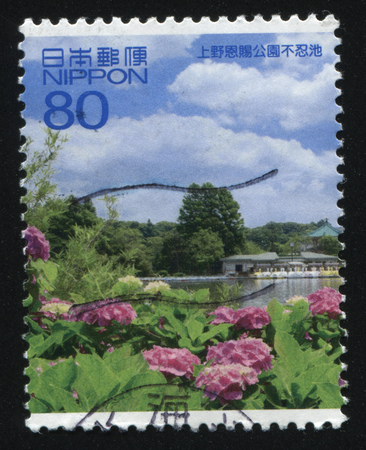 poststempel: RUSSIA KALININGRAD, 19 APRIL 2016: stamp printed by Japan, shows a lake Plants in blossom, some houses , circa 2010