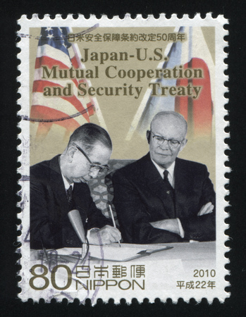 parliamentarian: RUSSIA KALININGRAD, 22 APRIL 2016: stamp printed by Japan, shows two statesmen signing security treaty, circa 2010