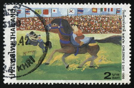 fandom: RUSSIA KALININGRAD, 2 JUNE 2016: stamp printed by Thailand, shows the child riding a horse, circa 1999 Editorial