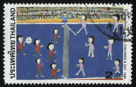 fandom: RUSSIA KALININGRAD, 2 JUNE 2016: stamp printed by Thailand, shows  playing children, circa 1999
