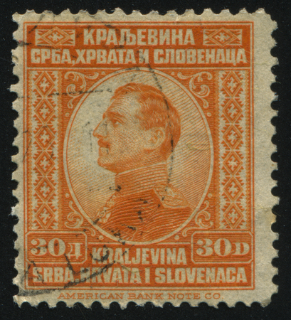 statesman: RUSSIA KALININGRAD,12 NOVEMBER 2016: stamp printed by Yugoslavia, shows King Alexander, circa 1924