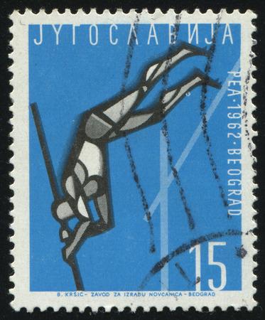 RUSSIA KALININGRAD, 12 NOVEMBER 2016: stamp printed by Yugoslavia, shows high jumper, circa 1962