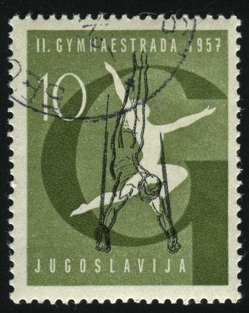 zagreb: RUSSIA KALININGRAD, 12 NOVEMBER 2016: stamp printed by Yugoslavia, shows a Gymnast at gymnastic meet in Zagreb, circa 1957
