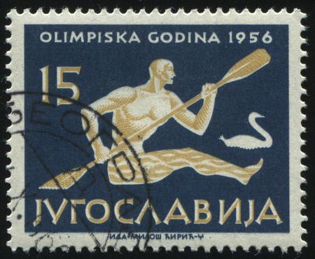 RUSSIA KALININGRAD, 12 NOVEMBER 2016: stamp printed by Yugoslavia, shows Paddling Kayak, circa 1956