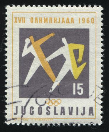 olympic symbol: RUSSIA KALININGRAD, 12 NOVEMBER 2016: stamp printed by Yugoslavia, shows athletics, circa 1960