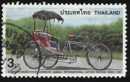 RUSSIA KALININGRAD, 2 JUNE 2016: stamp printed by Thailand, shows an empty pedicab, 1997
