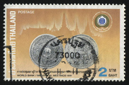 coining: RUSSIA KALININGRAD, 2 JUNE 2016: stamp printed by Thailand, shows a coin, 1991