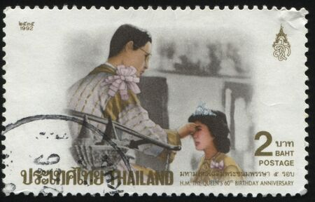 anointed: RUSSIA KALININGRAD, 2 JUNE 2016: stamp printed by Thailand, shows Queen with crown, being anointed, circa 1992