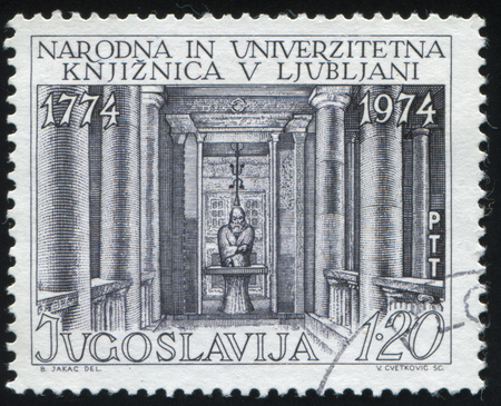 faculty: RUSSIA KALININGRAD, 12 NOVEMBER 2016: stamp printed by Yugoslavia, shows the Library and Primoz Trubar Statue at the University of Ljubljana, circa 1974 Editorial